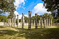 Old ruins of columns in a grassy field, The Market, Chichen Itza, Yucatan, Mexico