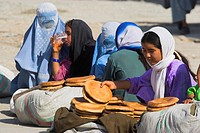 Girls selling bread on the street, Mazar_I_Sharif, Afghanistan, Asia