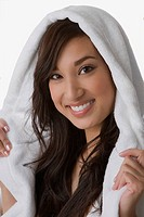 Close_up of a young woman wrapped in a towel and smiling