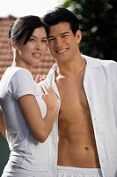 Close-up of a young couple smiling (thumbnail)