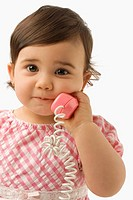 Portrait of a girl using a toy phone