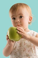 Close_up of a girl holding an apple