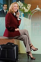 Mature woman talking on a mobile phone (thumbnail)