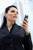 Close_up of a businesswoman holding a mobile phone