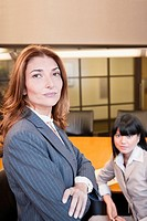 Portrait of a two businesswomen in a board room (thumbnail)