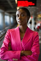 Portrait of a businesswoman standing with her arms crossed at a subway station