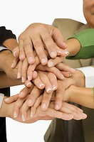 Close_up of business executives stacking hands