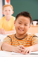 Portrait of a schoolboy smiling in a classroom