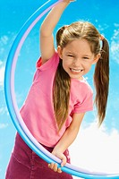 Portrait of a girl playing with two plastic hoops