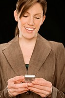 Close_up of a businesswoman text messaging