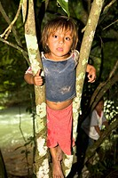 Portrait of a boy climbing a tree, Agua Azul Cascades, Chiapas, Mexico