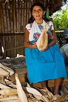 Portrait of a mature woman peeling corn, Papantla, Veracruz, Mexico