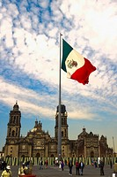 Low angle view of the Mexican flag in front of a cathedral, Metropolitan Cathedral, Zocalo, Mexico City, Mexico