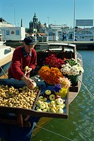 Flowers, potatoes and onions for sale on the waterfront of the harbour in Helsinki, Finland, Scandinavia, Europe