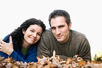 Portrait of a couple lying on leaves