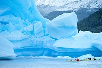 People kayaking near floating icebergs, Lago Gray Lake Gray, Torres del Paine National Park, Patagonian Andes, Patagonia, Chile, South America