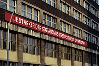 Socialist propaganda at a facade, East_Berlin, GDR