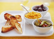 Tapas: pumpkin dip with chillies and olives, toasted bread