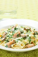 Ribbon pasta with shellfish and chopped parsley