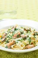 Ribbon pasta with shellfish and chopped parsley