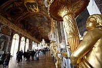 Beautifully guilded lamps decorating the Hall of Mirrors in Chateau of Versailles, Paris. France
