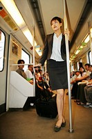 One Businesswoman Standing With A Luggage In The Subway Train,Shanghai,China