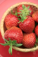 Fresh strawberries in a basket overhead view
