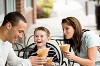 family (ages 26, 25 and 6) eating ice cream cones
