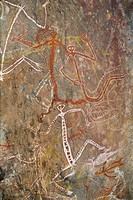 Dancing figures at Nourlangie Rock, aboriginal shelter and rock art site in Kakadu National Park, UNESCO World Heritage Site, Northern Territory, Aust...