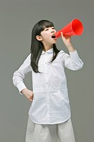Girl shouting through loudspeaker