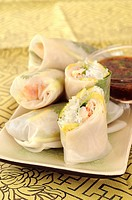 Rice paper rolls filled with pineapple, avocado & shrimps