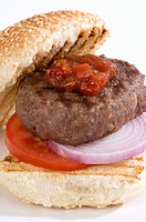 Grilled beefburger with tomato relish in a bun