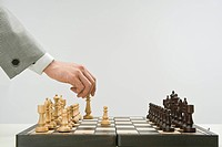 Businessman playing chess, close_up