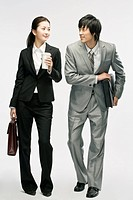 Businesswoman and man going to work