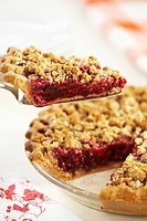 Removing Slice of Berry Streusel Pie