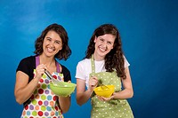 friends posing with cooking Bowls, Whisks, Aprons, fun, game, smiles, happy, teenagers