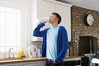 Young man drinking milk