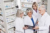 Pharmacists reading file together