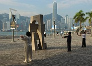 Early morning Tai Chi class on the Tsim Sha Tsui waterfront, Kowloon, Hong Kong, China, Asia