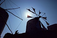 Woman and goat under sail driven windmills, Olimbos, Karpathos, Greece, Europe