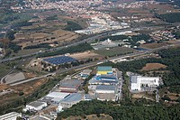 Spain, Catalonia, Barcelona, Barcelonés, industrial area in Santa Agnès de Malanyanes, AP-7 freeway in background, AVE (high speed train) course to Gi...