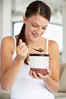Young Woman Eating Chocolate Ice_Cream