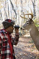 Hunter face to face with a deer