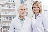 Portrait of two smiling pharmacists
