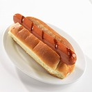 Grilled Hot Dog on a Plate, White Background