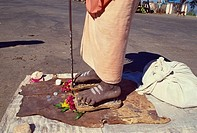 Close_up of the feet of a Hindu Saddhu or holy man standing on a bed of nails, in Mysore, Karnataka, India, Asia