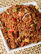 Fried rice with pork, vegetables and sprouts