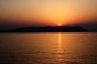 Sunset over the Aegean, taken from Loutraki, Skopelos, with Skiathos in background, Sporades Islands, Greek Islands, Greece, Europe