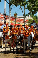 Feria de Abril , Andalusian in typical costume on a horse , Seville , Andalusia , Spain , Europe , Harnesse team with coach,