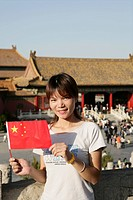 Chinese woman with flag, Forbidden City, Beijing, China, Asia